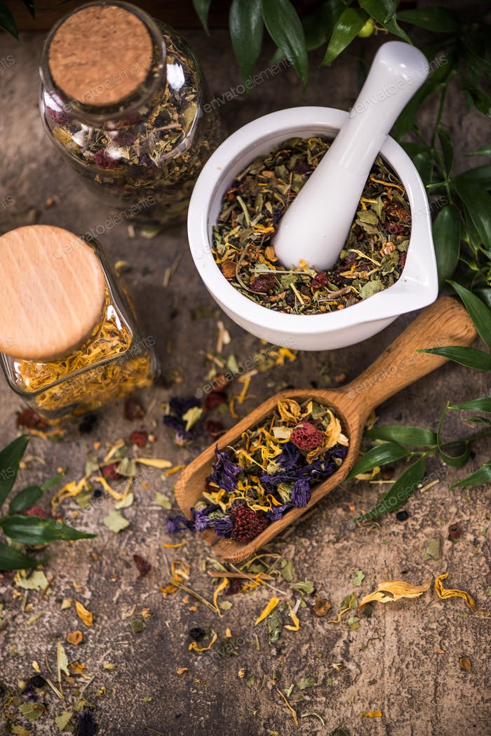 Aromatic healthy tea on wooden spoon
