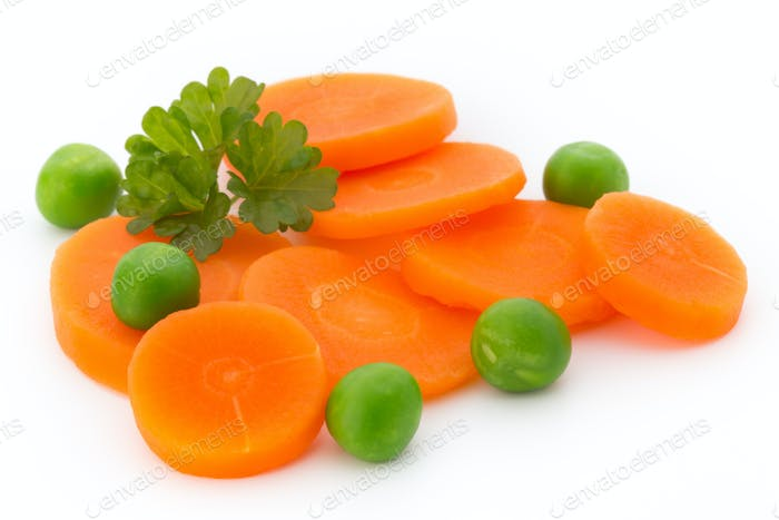 Carrot slice, green peas, isolated on white.