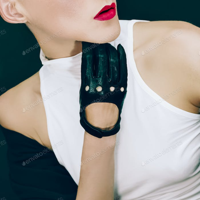 Stylish Sexy Model on black background in Trendy Gloves and Jac