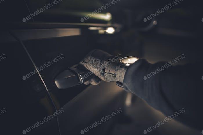 Thief Hand on a Door Handle