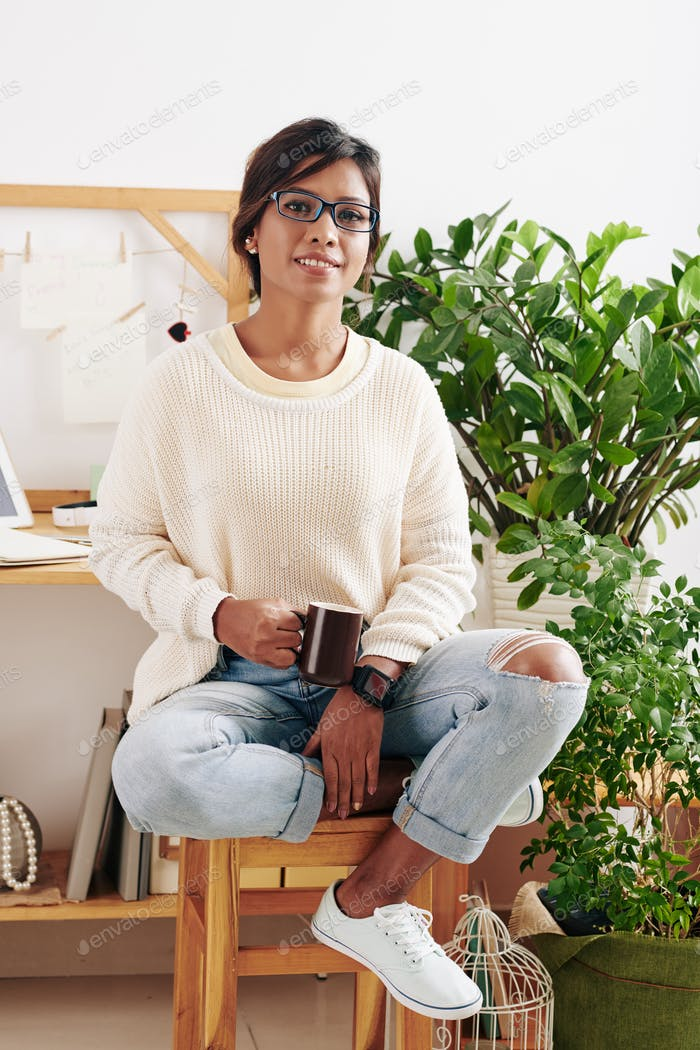 Lovely woman in her home office