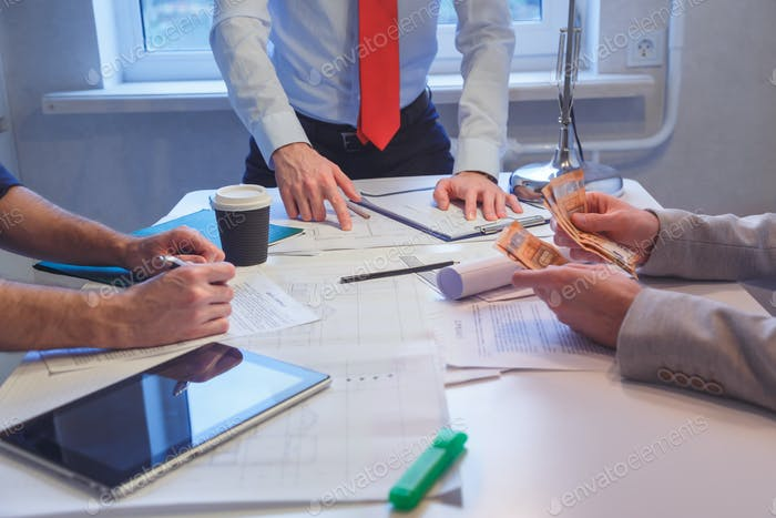 Close-up of Business people discussing a financial plan. Business meeting at the office