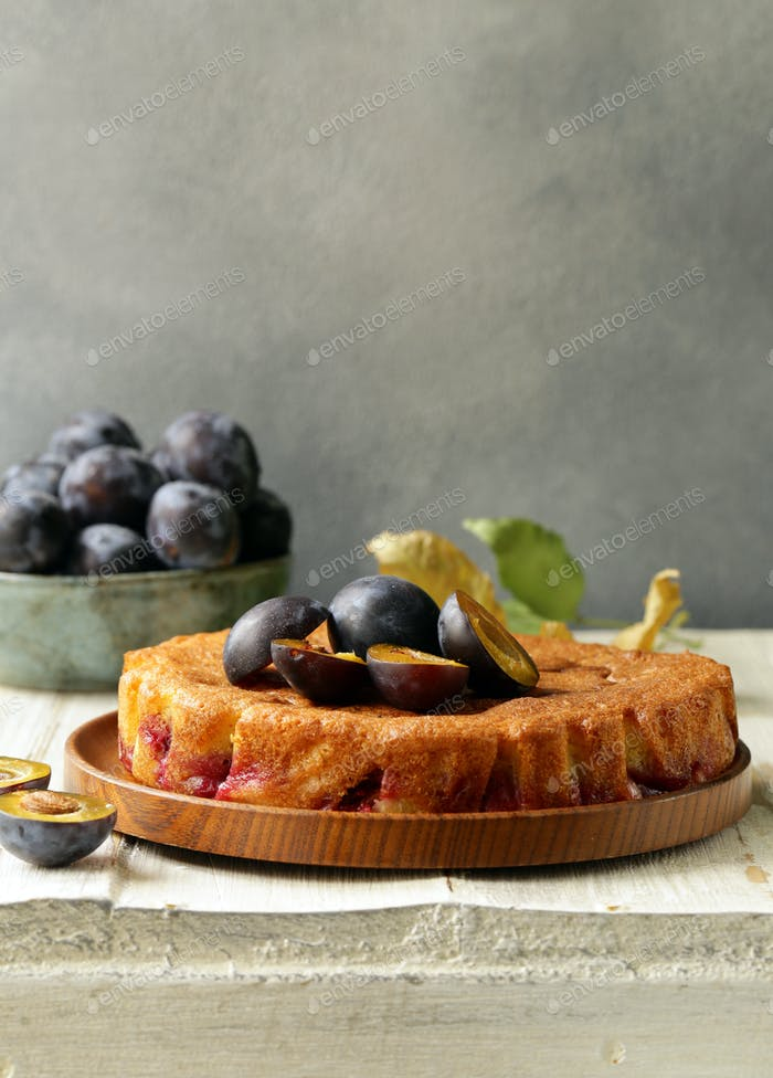 Plum Pie with Fresh Berries