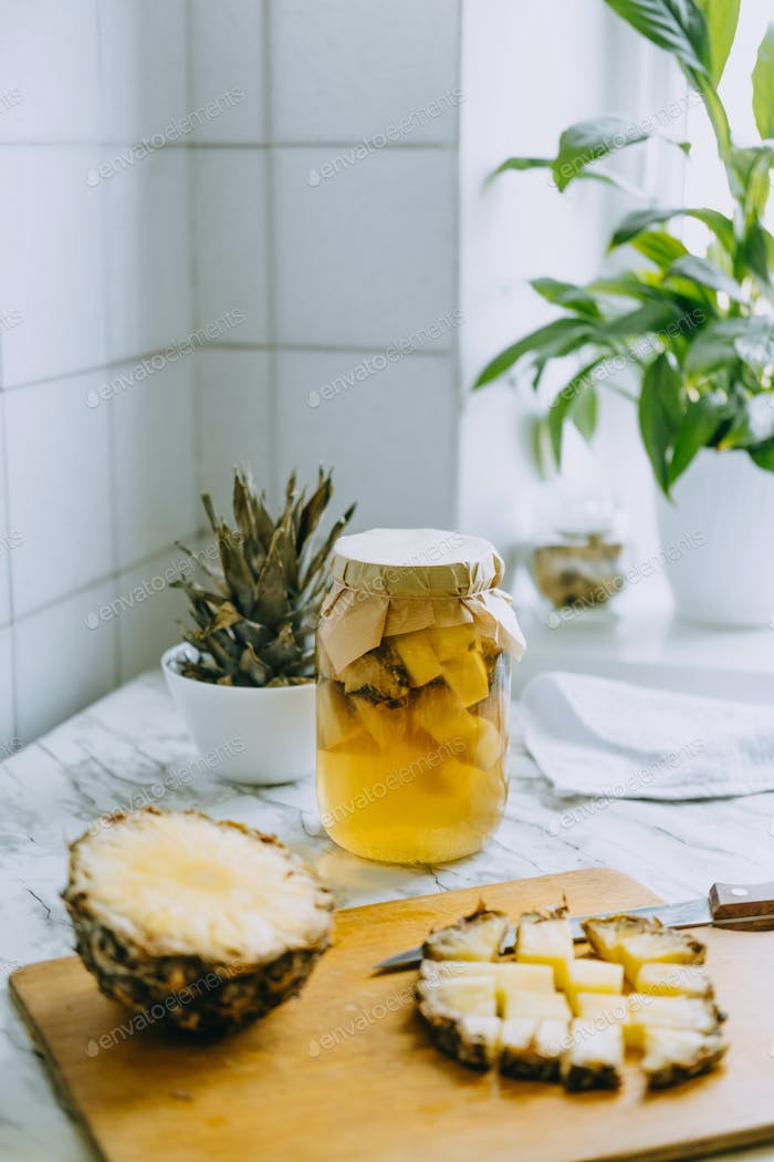 Fermented pineapple kombucha drink tepache. Cooking process of homemade probiotic superfood