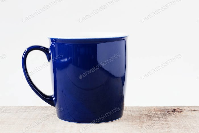 Blue cup on wooden.