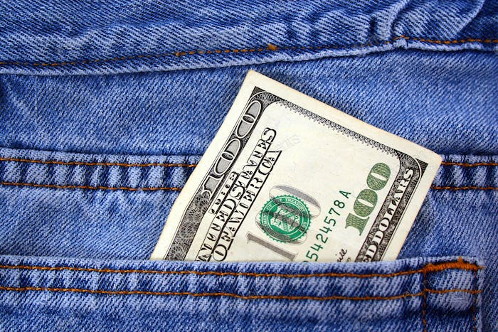 One hundred dollar bill in jeans pocket