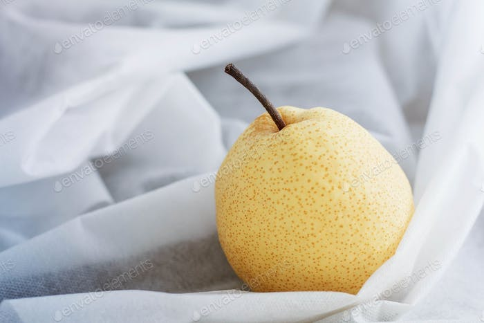 pear on white tablecloth
