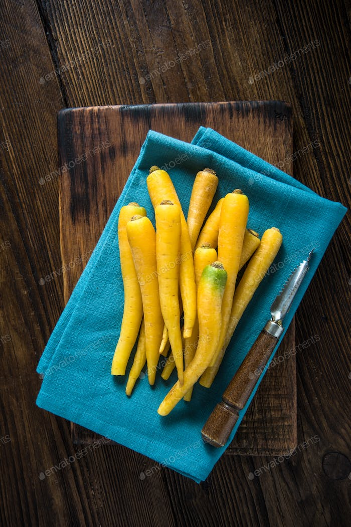 Yellow carrots on blue cloth