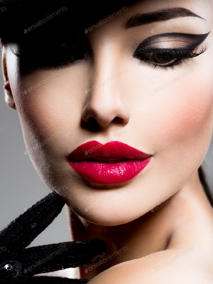 Сlose-up portrait of a woman  with red lips and fashion style m