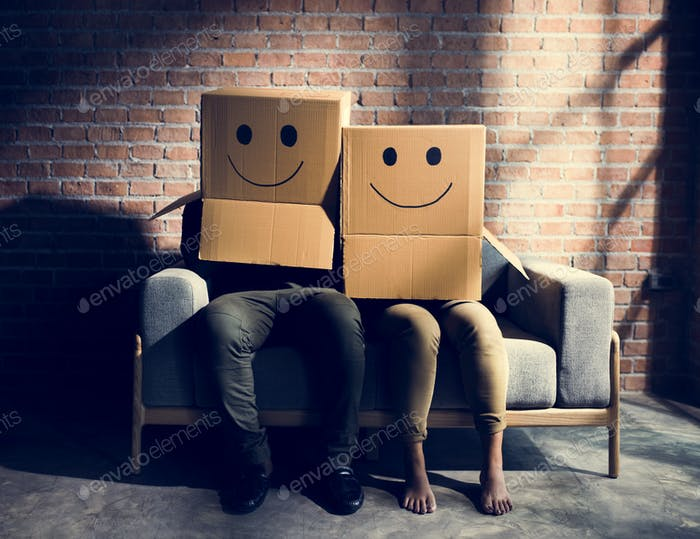 Couple wearing boxes with smiley faces