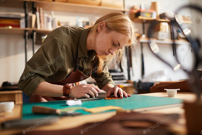 Woman doing Leatherwork