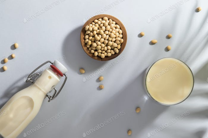 Soy milk and soy bean on gray table
