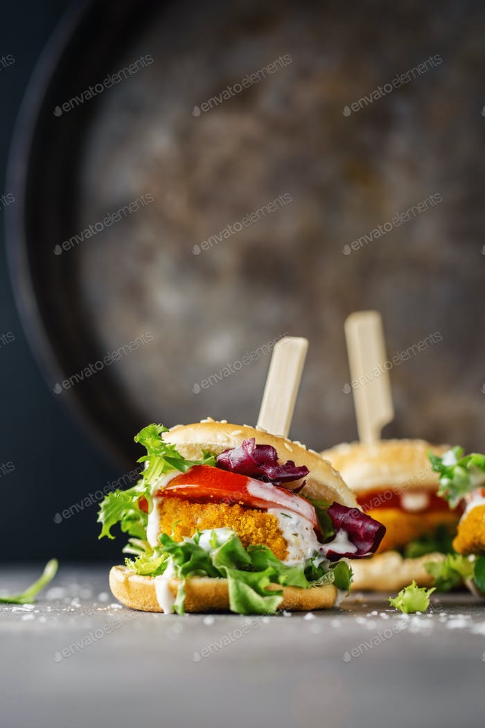 Burger with chicken patty and vegetables