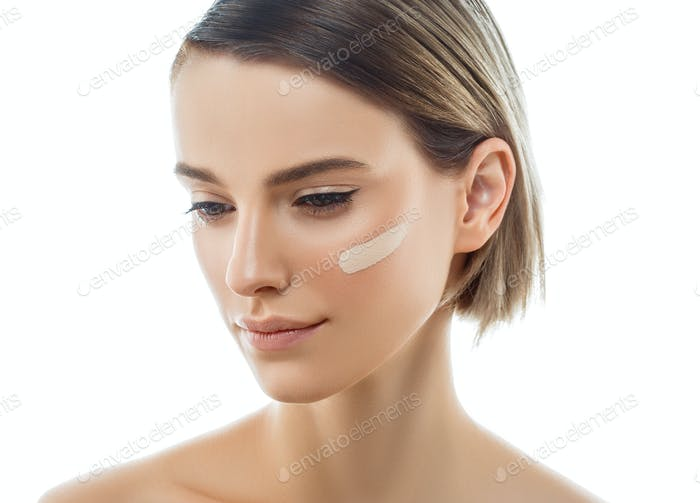 Beautiful woman portrait beauty skin healthy and perfect makeup Skin tone cream line on woman face.