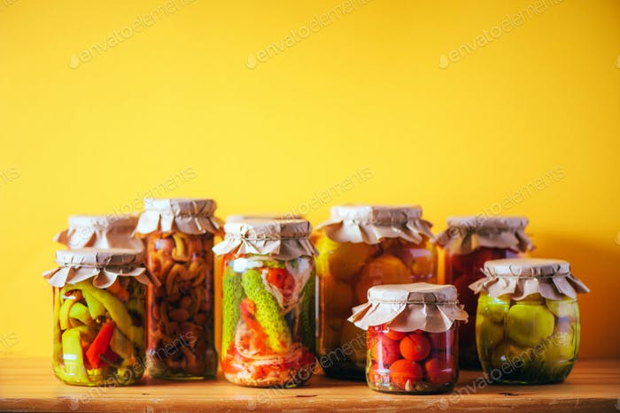 Preserved and fermented food in glass jars. Fermented food. Autumn canning. ?ucumber, squash and