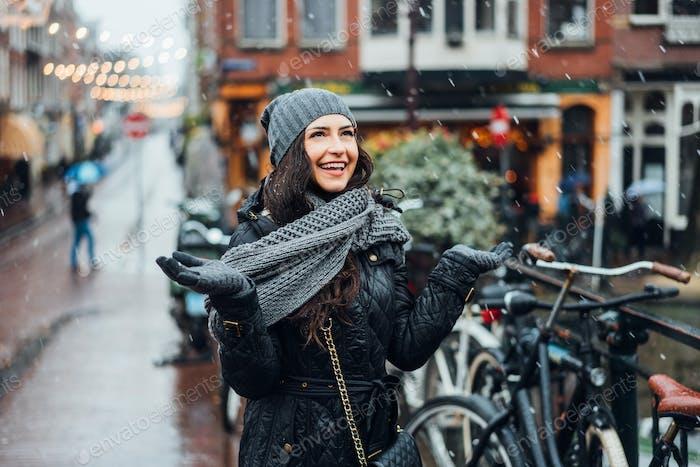 girl in the street in the rain