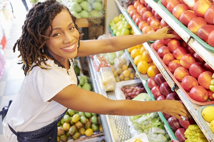 Woman working at fruit department