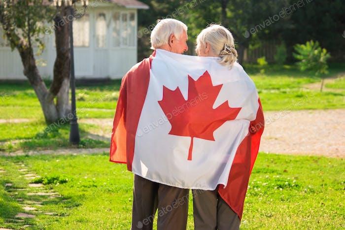 Senior couple and Canadian flag