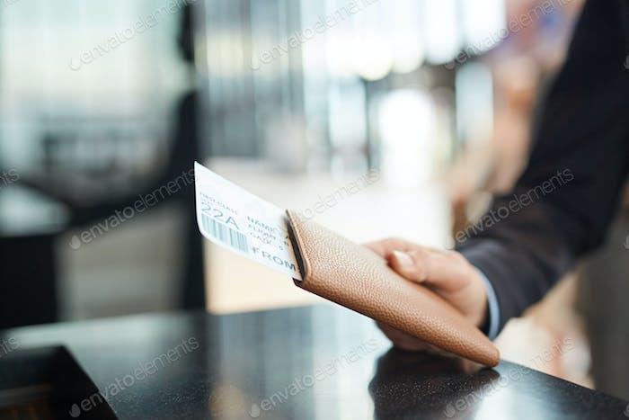 Hand Holding Passport And Flight Ticket