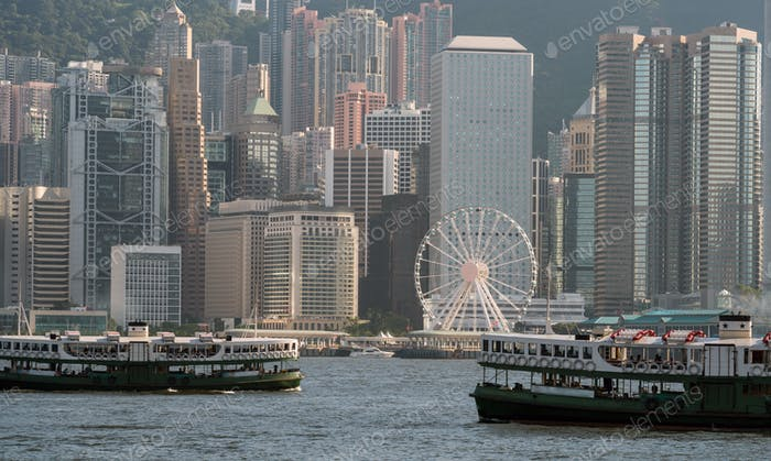 Scene of Hong Kong skyline with boats in Victoria Harbor