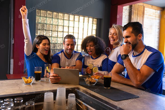 Supporters looking at the match on a touch pad