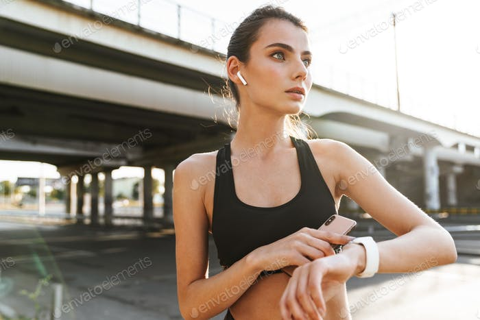 Amazing sports fitness woman listening music