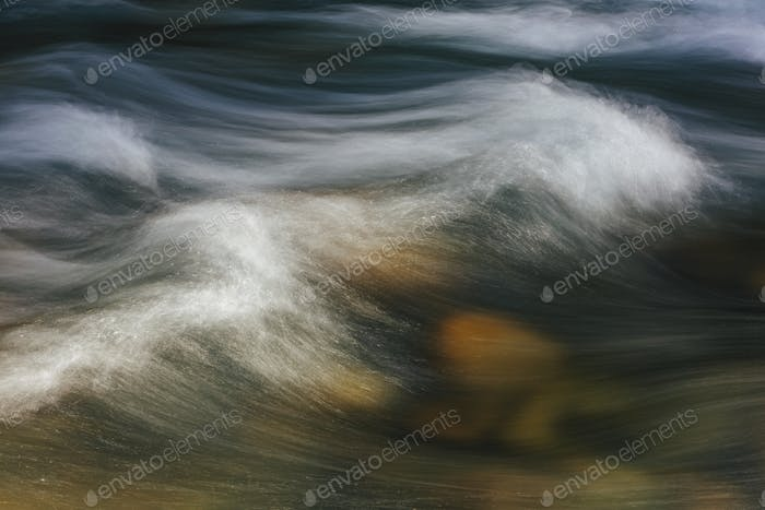 Long exposure abstract of flowing river water