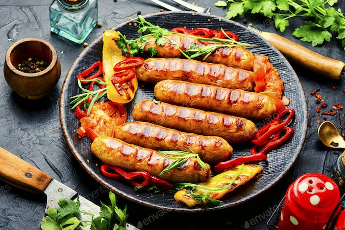 Tasty German grilled sausages with rosemary