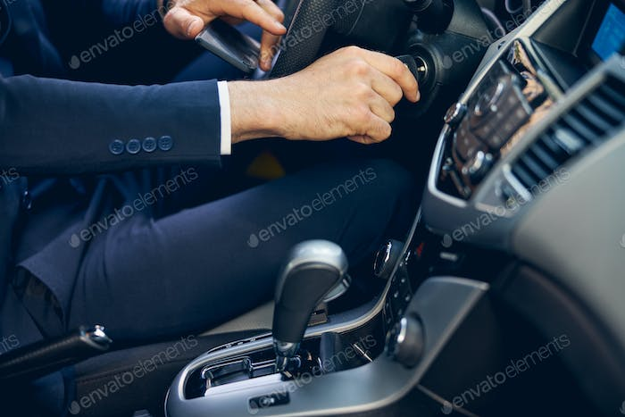 Man in suit going in car alone