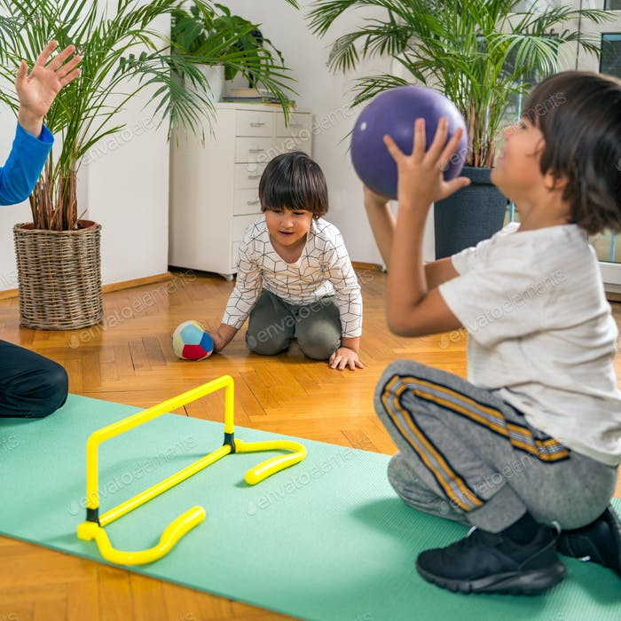 Children Playing with Ball Indoors