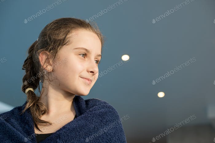 Wet ambitious girl dreaming of new achievements in swimming