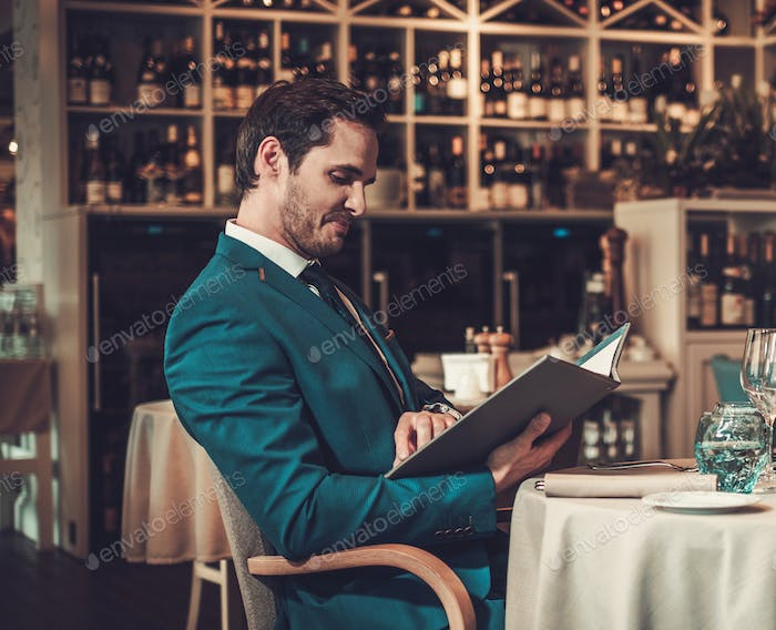 Man reading menu in a restaurant