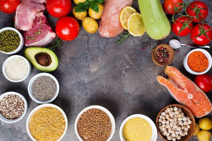 rustic assortment of paleo foods including, eggs, legumes, vegetables, fish, meat, muesli and pasta