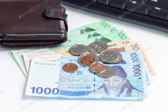 Different value South korean currency bill and coins near  wallet , save your money concept