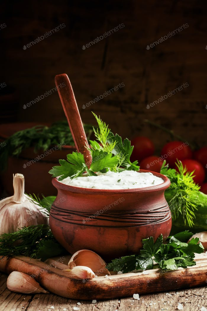 White Middle East sauce with cucumber, yoghurt, garlic and fresh herbs