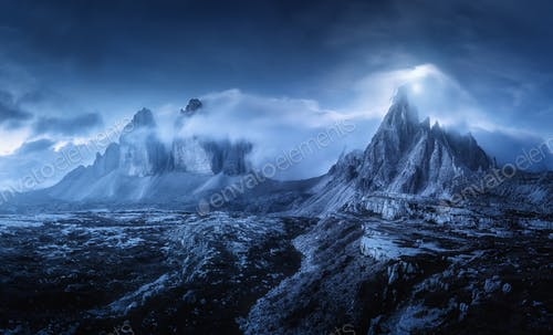Mountains in fog at beautiful night. Dreamy landscape