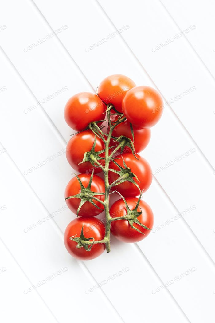 Branch of red cherry tomatoes.
