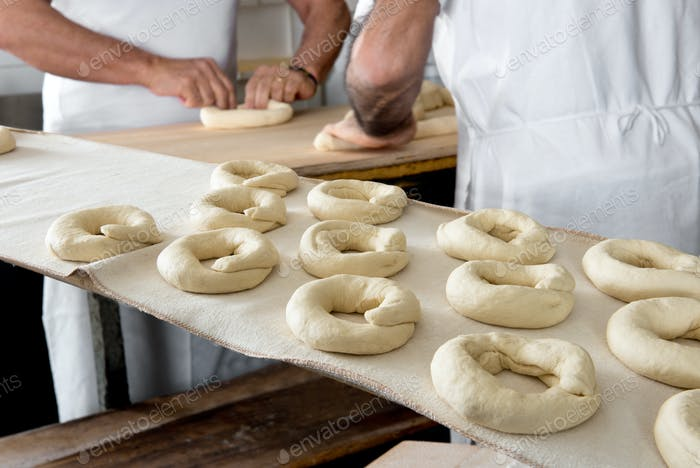 Bakers making dough for bagels