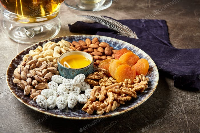 Assorted nuts and dried fruits in oriental style on a platter
