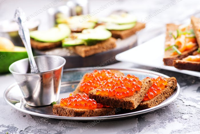 bread with red salmon caviar
