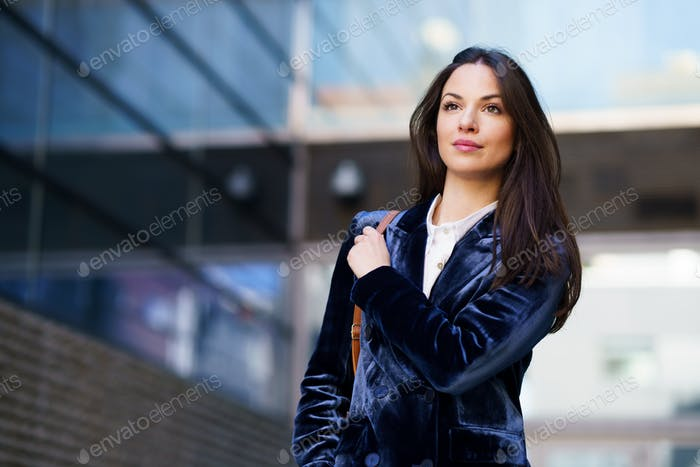 Business woman wearing blue suit outside an office building
