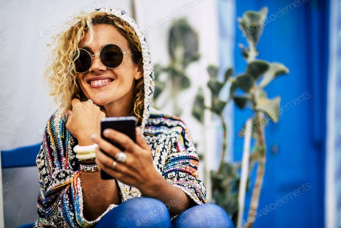 Beautiful woman use cellular phone and smile