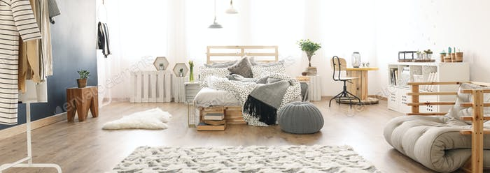 Bed in the bright room