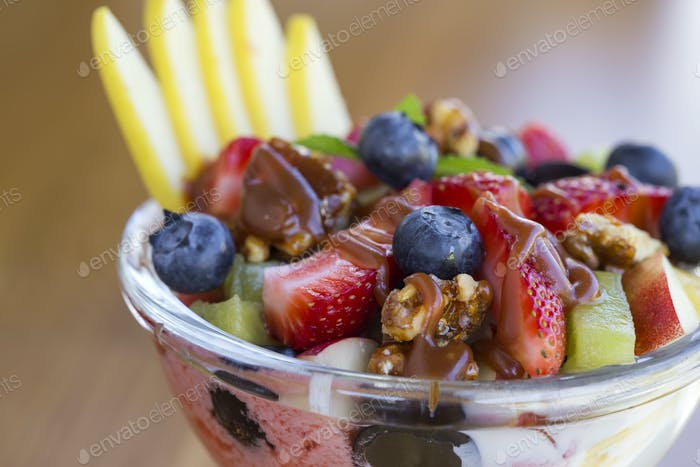 Bowl with fruit salad and caramel topping