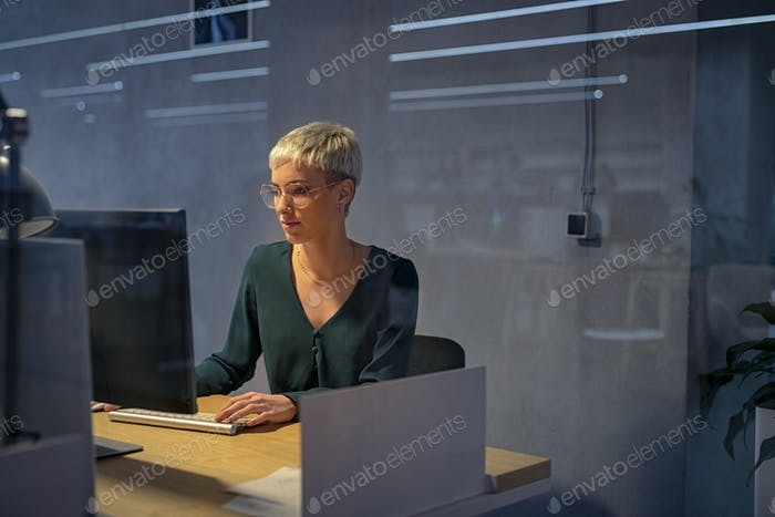 Business woman working late on computer