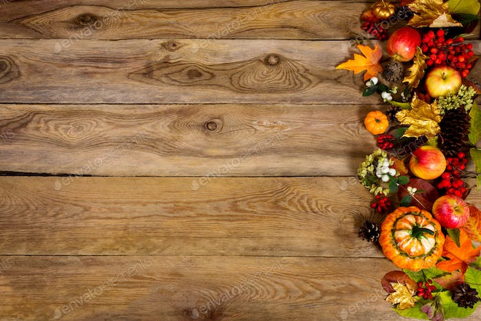 Thanksgiving background with pumpkin, apples and golden leaves,