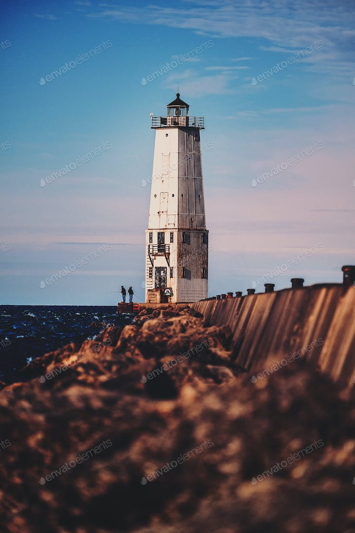 Fishermen and lighthouse