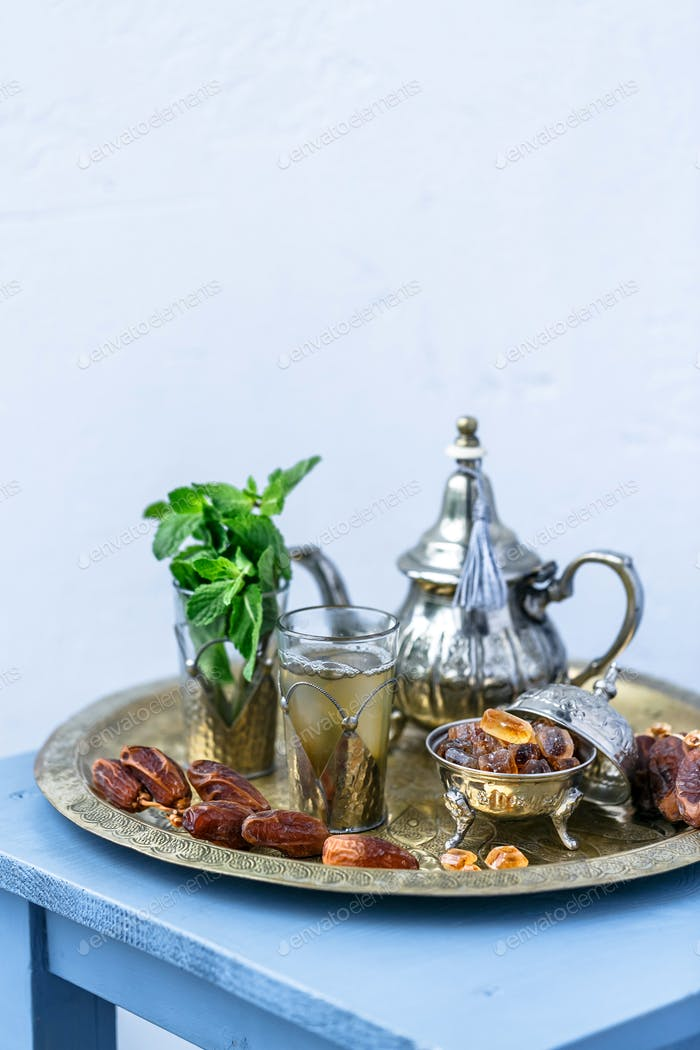 Traditional Moroccan mint tea on white background, selected focus