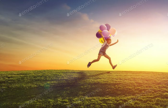 child is playing with balloons