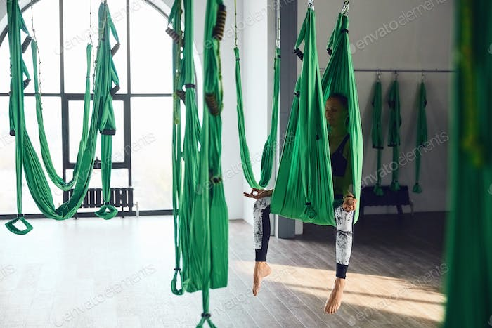 Aerial different inversion antigravity yoga with a hammock